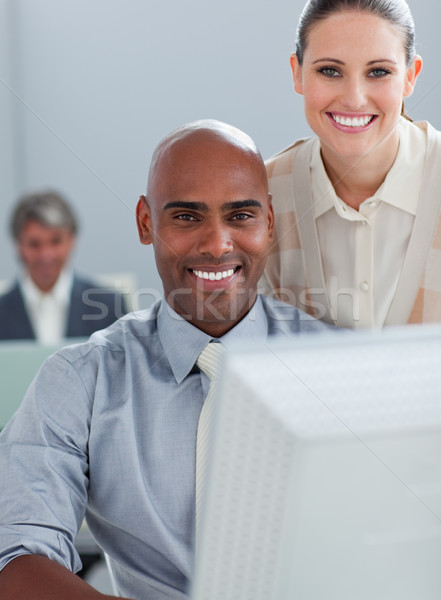 Assertive business partners working at a computer together Stock photo © wavebreak_media
