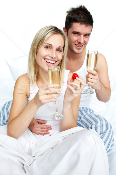 Feliz homem mulher compromisso champanhe Foto stock © wavebreak_media