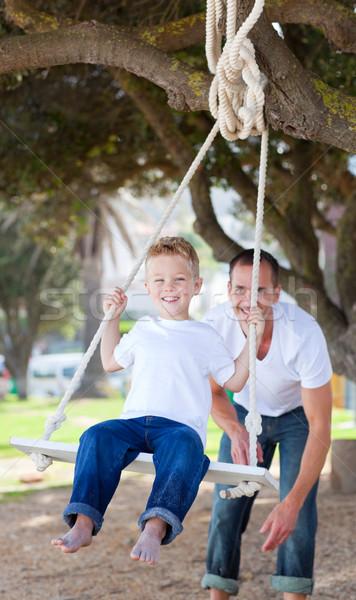 陽気な 父 プッシング スイング 公園 ストックフォト © wavebreak_media