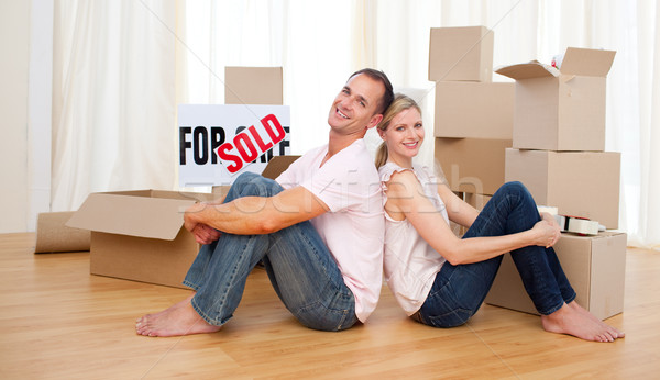 Smiling couple relaxing while moving Stock photo © wavebreak_media