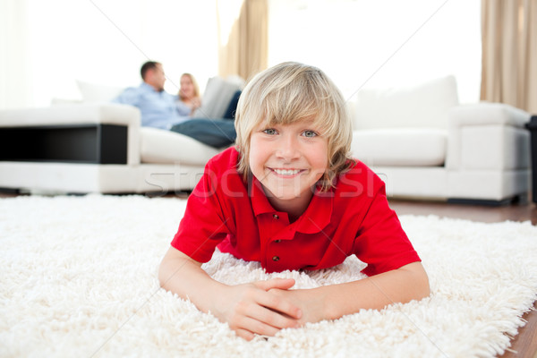 Jolly boy lying on the floor Stock photo © wavebreak_media