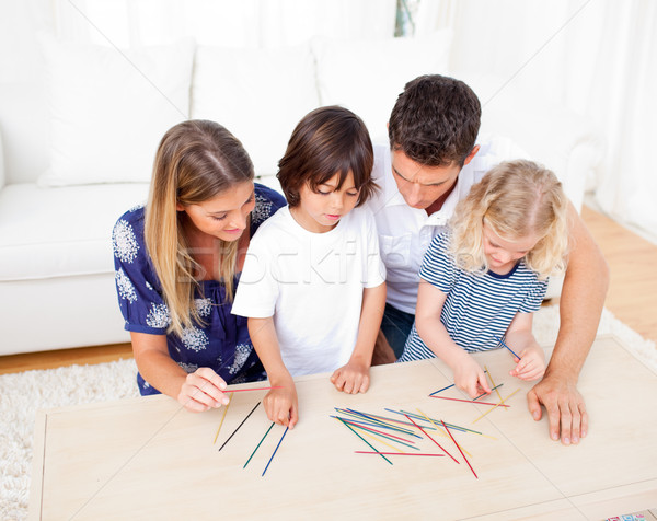 Loving family playing mikado in the living room Stock photo © wavebreak_media