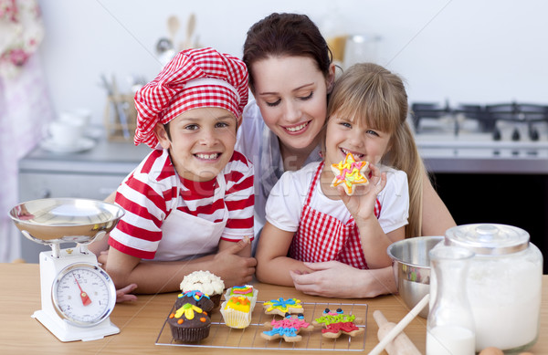Smiling mother and children baking in the kitchen Stock photo © wavebreak_media