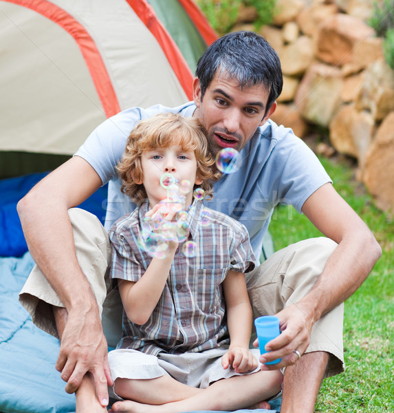 Férfi gyerek buborékfújás sátor boldog gyermek Stock fotó © wavebreak_media