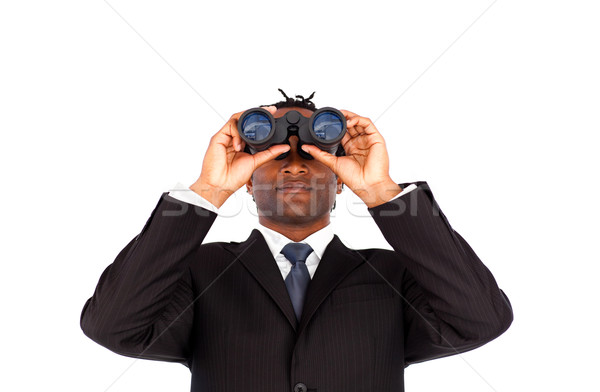 Charismatic Afro-American businessman with binoculars against a white background Stock photo © wavebreak_media