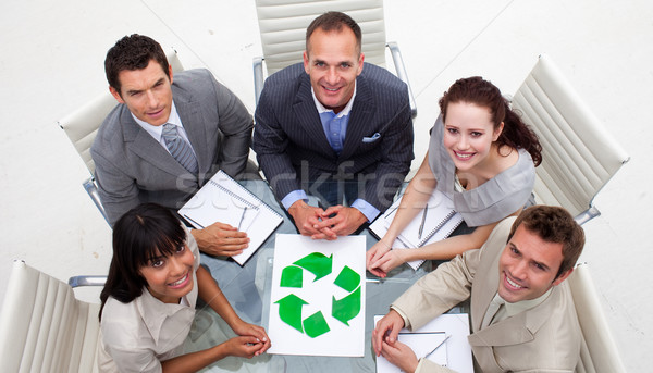 High angle of smiling business team holding a recycling symbol Stock photo © wavebreak_media