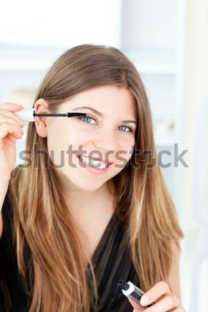 Radiant woman using a powder brush in her bathroom at home Stock photo © wavebreak_media