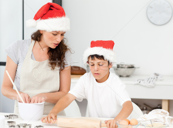 Mother and son preparing Christmas biscuits together in the kitchen Stock photo © wavebreak_media