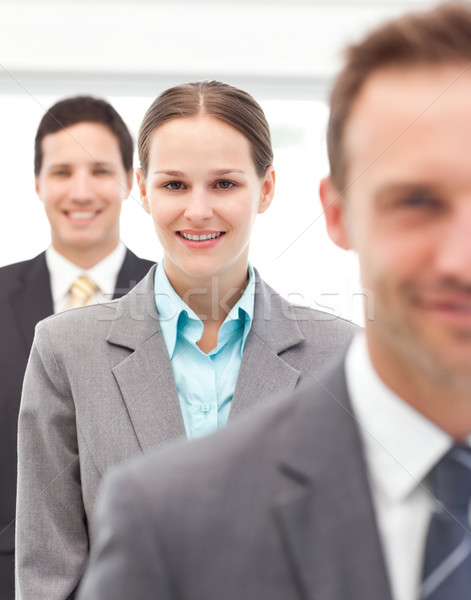 Happy businesswoman standing in a row with her two partners at work Stock photo © wavebreak_media