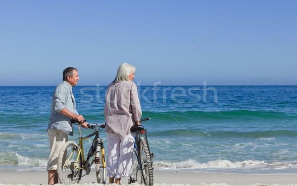 Senior couple with their bikes on the beach Stock photo © wavebreak_media