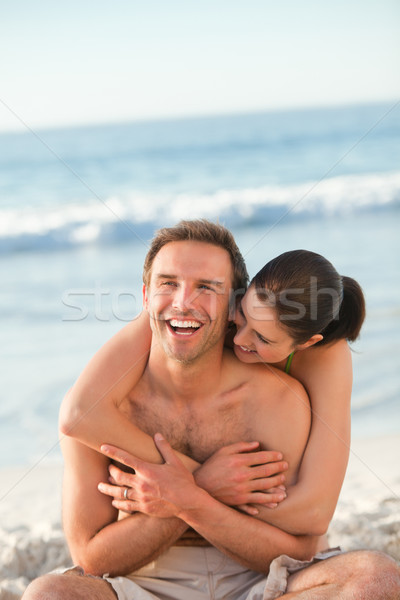 Enamored couple hugging on the beach Stock photo © wavebreak_media