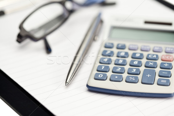 Note pad, pen, glasses and pocket calculator on a white background Stock photo © wavebreak_media