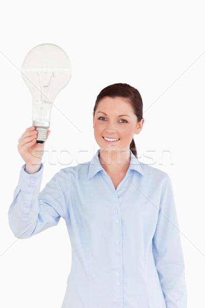 Guapo femenino bombilla pie blanco Foto stock © wavebreak_media