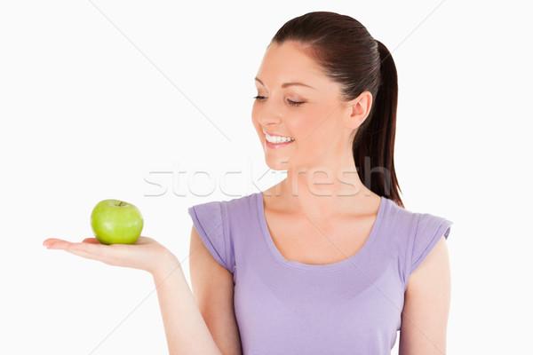 Bonne recherche femme pomme permanent blanche Photo stock © wavebreak_media