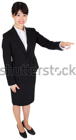 Good looking female in suit posing while standing against a white background Stock photo © wavebreak_media