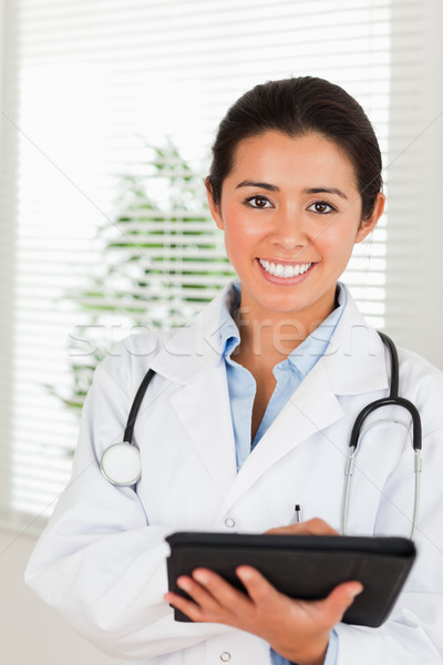 Stock fotó: Káprázatos · női · orvos · sztetoszkóp · ír · notebook