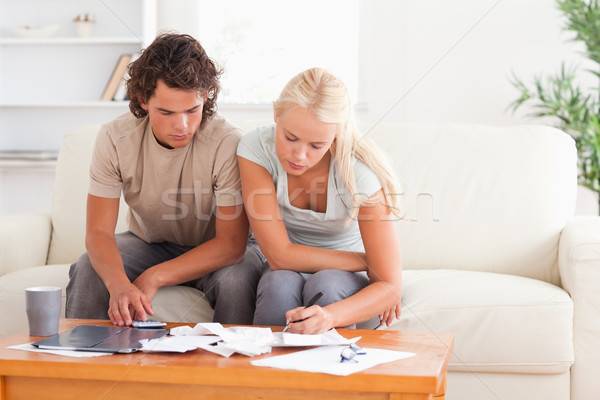 Stock photo: Working couple sitting in the living room