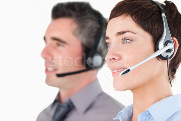 Close up of operators with headsets against a white background Stock photo © wavebreak_media