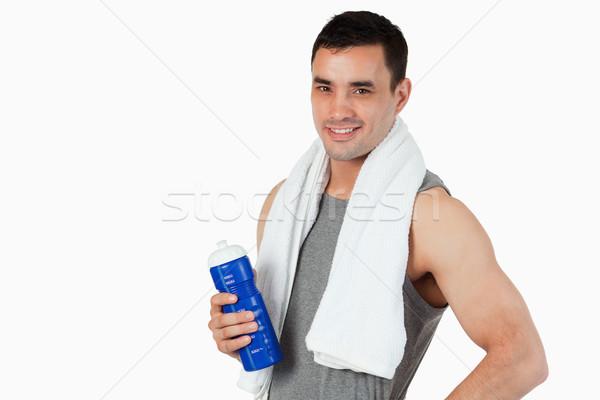 Młodych mężczyzna butelki treningu biały sportu Zdjęcia stock © wavebreak_media