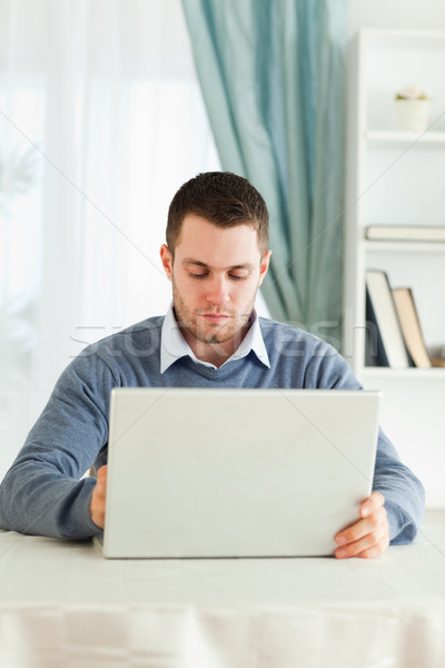 Young man with his laptop in his homeoffice Stock photo © wavebreak_media