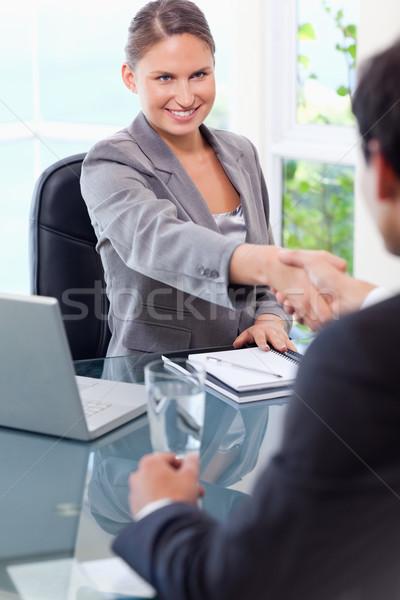 улыбаясь молодые деловая женщина клиентов служба бизнеса Сток-фото © wavebreak_media