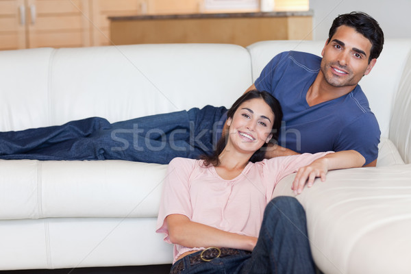 Smiling couple posing in their living room Stock photo © wavebreak_media