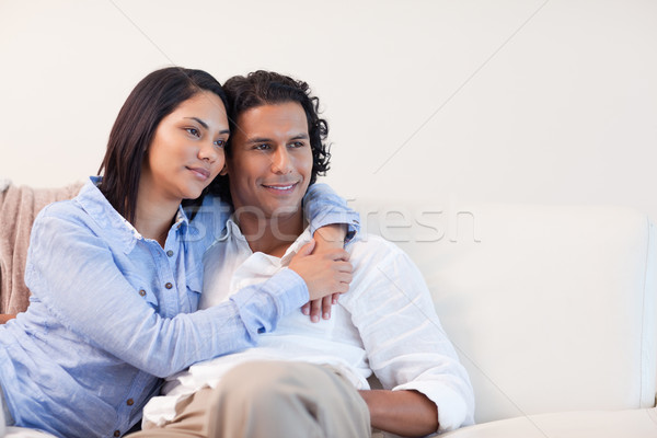 Young couple on the couch hugging Stock photo © wavebreak_media