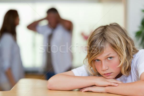 Triste regarder garçon parents derrière Photo stock © wavebreak_media