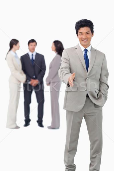 Venditore squadra dietro offrendo mano bianco Foto d'archivio © wavebreak_media