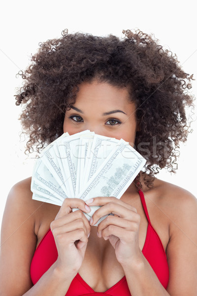 Brunette vrouw verbergen gezicht achter fan Stockfoto © wavebreak_media