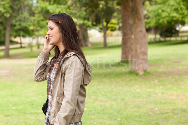 Side view of a teenager phoning in a park Stock photo © wavebreak_media