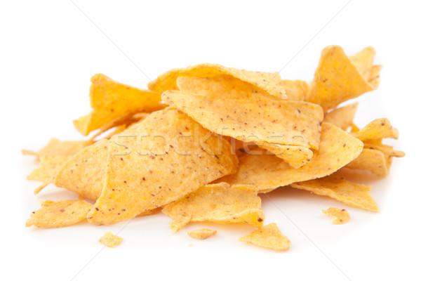 Stack of triangular chips against white background Stock photo © wavebreak_media