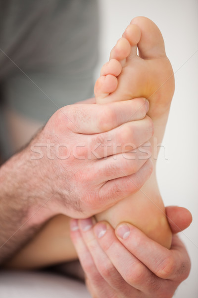 Hands of a practitioner holding a barefoot in a room Stock photo © wavebreak_media