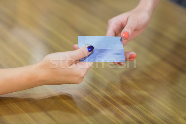 Stock photo: Passing credit card at cash register