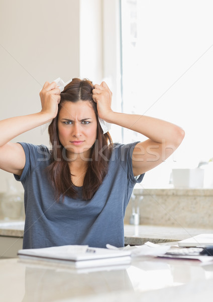 Woman feeling angry about bills in kitchen Stock photo © wavebreak_media