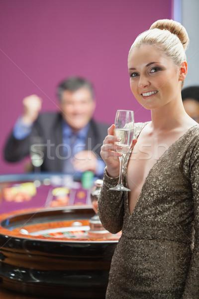 Mulher champanhe em pé roleta homem Foto stock © wavebreak_media