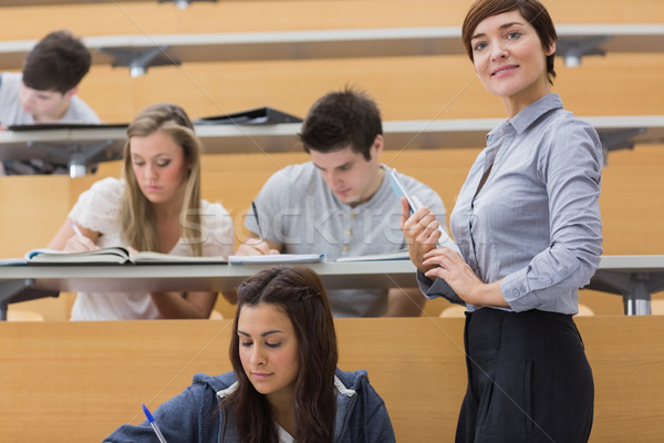 Diákok dolgozik tanár mosolyog előadás előcsarnok Stock fotó © wavebreak_media