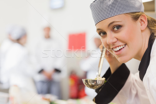 Smiling chef about to taste soup in kitchen Stock photo © wavebreak_media