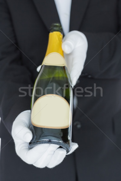 Close view of open bottle of champagne held by waiter Stock photo © wavebreak_media