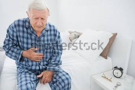 高齢者 男 腹 痛み ベッド ストックフォト © wavebreak_media