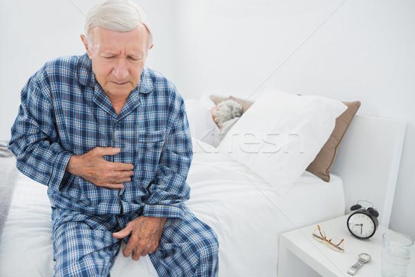 Homme souffrance ventre douleur maison Photo stock © wavebreak_media