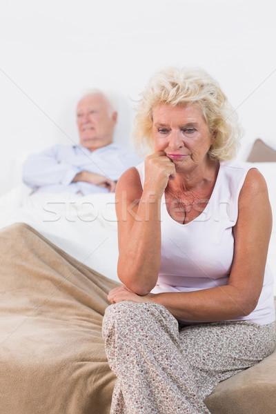 Yaşlı kadın oturma yatak yaşlı adam kadın ev Stok fotoğraf © wavebreak_media