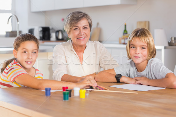 Granny and her grandchildren looking at camera with smile Stock photo © wavebreak_media