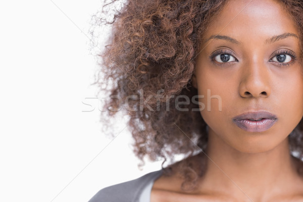 Unsmiling woman looking at camera Stock photo © wavebreak_media