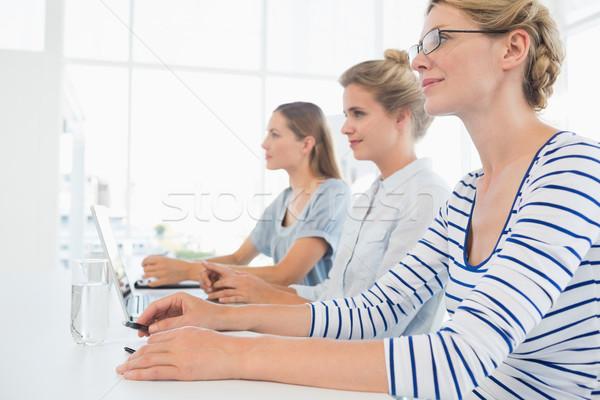 Concentré personnes travaillant bureau trois jeunes travail Photo stock © wavebreak_media