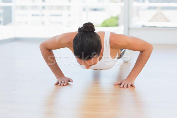 Vastbesloten mooie vrouw gymnasium mooie jonge vrouw Stockfoto © wavebreak_media