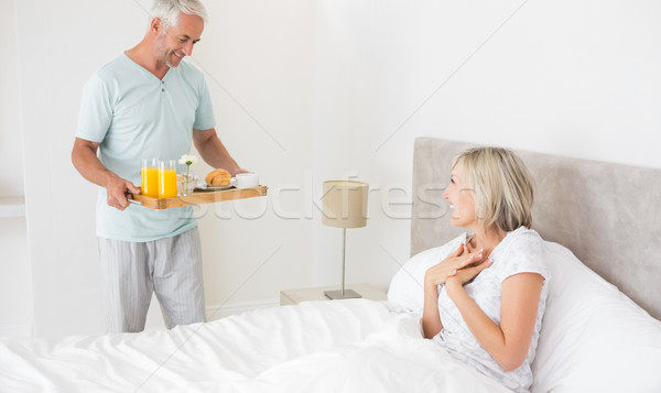 Man serving woman breakfast in bed Stock photo © wavebreak_media