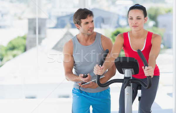 Male instructor working out at spinning class Stock photo © wavebreak_media