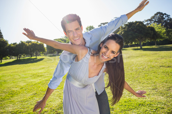 Happy couple with arms outstretched at park Stock photo © wavebreak_media