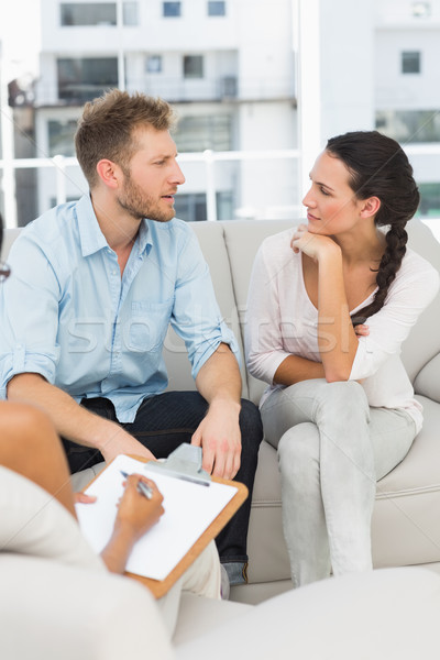 Stock photo: Unhappy couple talking at therapy session